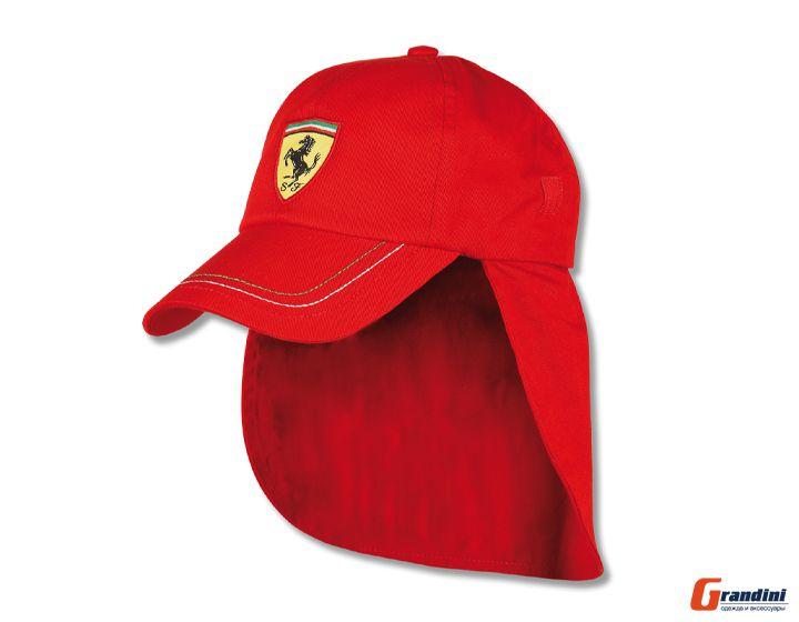 Красная кепка с логотипом Ferrari.  На козырьке три строчки итальянских...